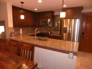 The kitchen includes granite counter tops with stainless steel appliance and heated tile floors.