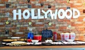 hollywood sign on brick wall