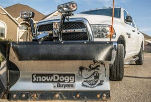 Snow plow hooked up to a pickup truck