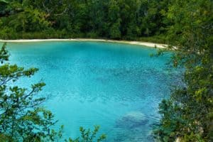 Crystal clear blue lake in the highlands of West Papua