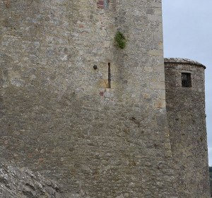 Cannon Ball embedded in the wall of Cahir Castle to the left of the window - The Irish Place