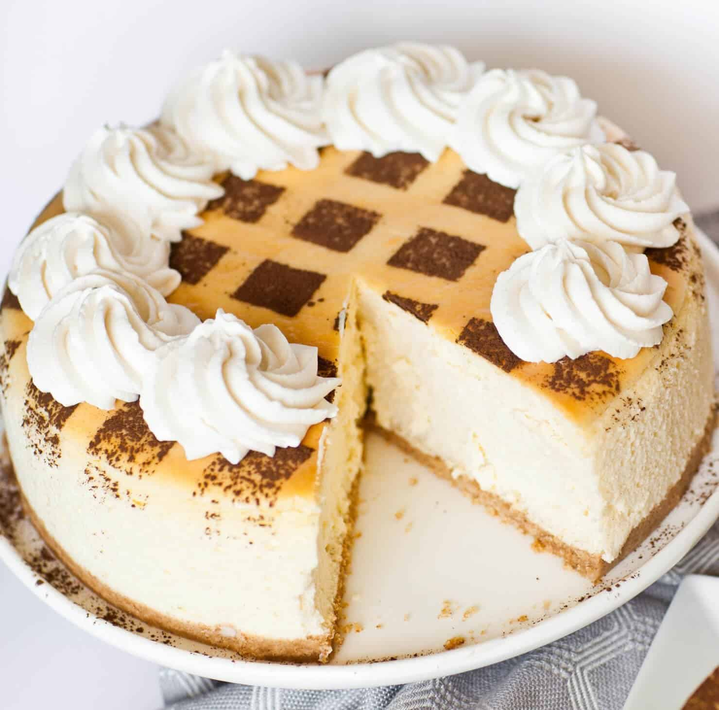 tiramisu cheesecake with whipped cream