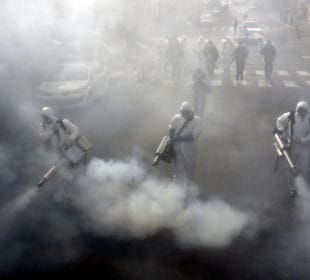 Iranian Firefighters disinfect streets in the capital Tehran