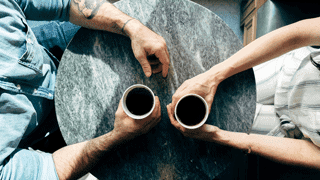 Mentoring - Two people sharing coffee