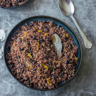 rice and beans in a dark bowl