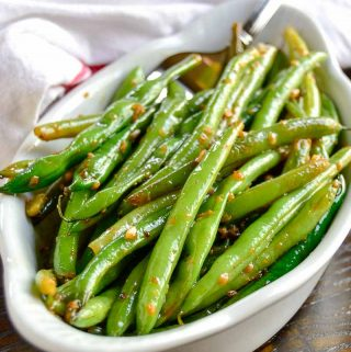 Screaming skillet green beans get their name from the screaming hot skillet used to cook them. Laced with garlic and the fruity citrus notes of white wine, they make a great summer side dish.