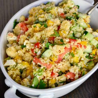 Light, refreshing, and full of garden fresh herbs and vegetables, this veggie couscous salad is a yummy addition to any spring or summer meal.