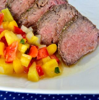 Summertime is grilling time and this tri-tip with pineapple mango red pepper salsa is sure to impress. Forget the heat, get out of the kitchen and get grilling!