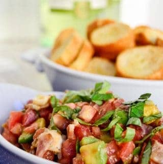 Loaded bruschetta is an inspired twist on a classic appetizer. Tomato, bacon, avocado, mozzarella, and basil piled on top of crispy, crunchy bread.