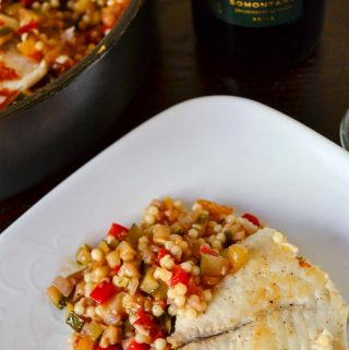 Loaded with the garden fresh vegetables this summer veggie couscous is topped with sauteed tilapia and paired with remarkably versatile garnacha wine.