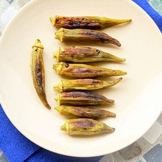 Roasted okra. Okra tossed with oil, salt and pepper and roasted until browned.