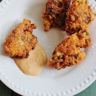 Okra Jalapeno Fritters. Sliced okra and chopped fresh jalapeno peppers mixed in a batter and fried. Served with Comeback Sauce.