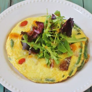 "Garden Vegetable Frittata. Use leftover or fresh vegetables and top with salad greens for a vegetable heavy meal. A great ""clean out your refrigerator"" option."