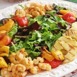 Grilled Shrimp and Fruit Salad. Wild caught Gulf shrimp, sweet bell peppers, nectarines and pineapple marinated in Creamy Honey Lime Dressing and grilled. Served atop a bed of spring lettuce mix.