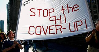 No cincidence here: 9-11 activists marching with a Stop the 9-11 Cover-Up banner
