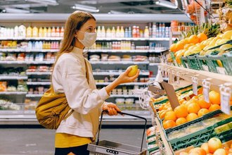 lady-shopping-vegetables-in-supermarket