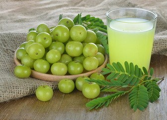 Fresh Amalaki and Indian gooseberry juice