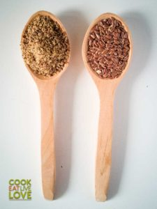Spoons showing the two different forms of flax available. On the left is the meal or ground version and on the right are the whole seeds.