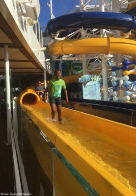 Kids love royal caribbean's water slides. This child emerges from a twisting slide.