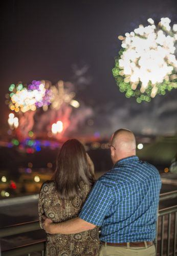 A couple watches fireworks for the california grill at the contemporary hotel