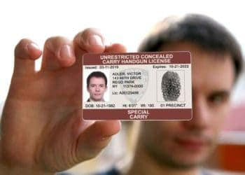 A man is holding his armed security license