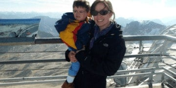 Mom and toddler enjoying a mountaintop view.