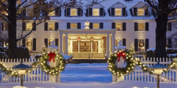 The woodstock inn in vermont offers guests a new england christmas with lots of locally cut trees, evergreen swags and lights.