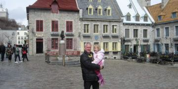 Father and daughter in quebec's lower old town.