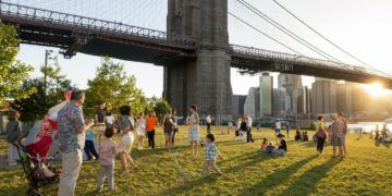 A nice lawn with skyline views at empire fulton ferry park