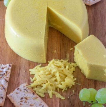 cheese board with cut up cheese