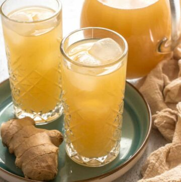 two glasses and jug of ginger beer