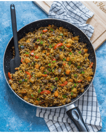 rice and meat in the skillet