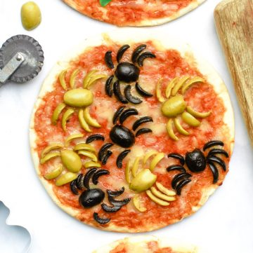 Overhead shot of a Halloween pizza with spider olives