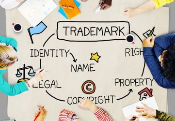 Trademark Registration Solicitor Leicester - Image shows people brainstorming elements of a trade mark