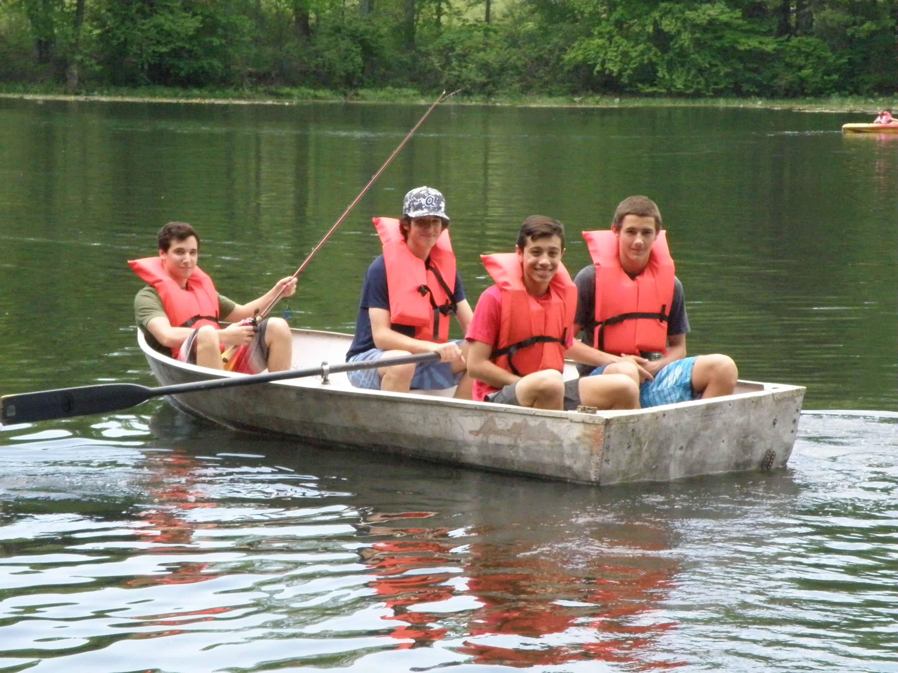 Four boys on a row boat