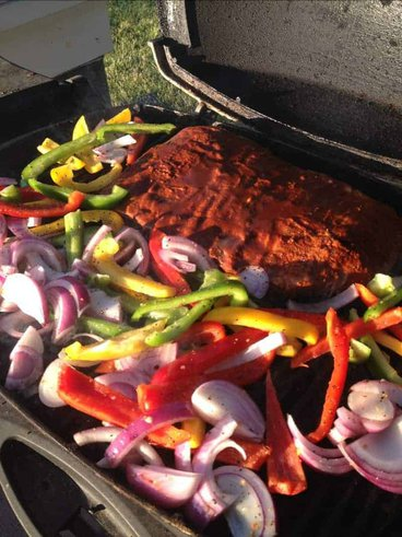 Fresh Veggies with Marinated Skirt Steak on the Grill Image