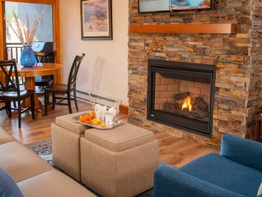 New wood flooring, stone fireplace, ceiling beams and beautiful new furniture make the living space of this one-bedroom Vail condo a relaxing place to unwind after a day of mountain adventures.
