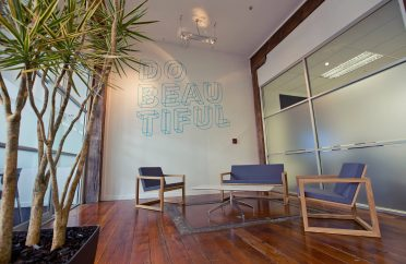 Photo of trendy office, with 'Do Beautiful' message on wall' where you might discuss outsourcing accountancy services
