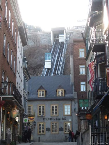 Cars going up and down the funicular in old town quebec.