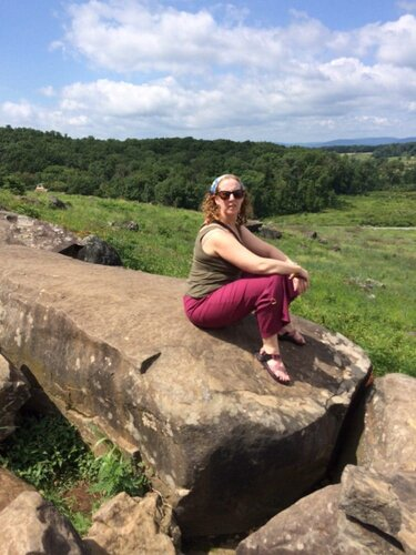 The writer on a rock on the union side of the gettysburg battlefield.