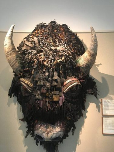 A paper maché buffalo head hangs in the new mexico capital building.
