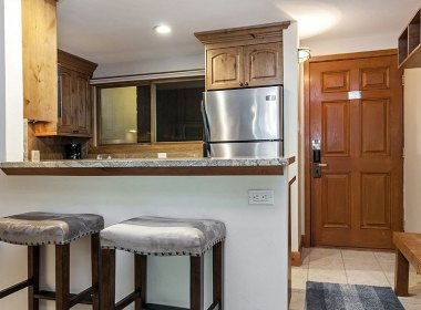 The entry and kitchen to Antlers at Vail Condo 209
