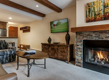 Living room includes gas fireplace and flat screen TV