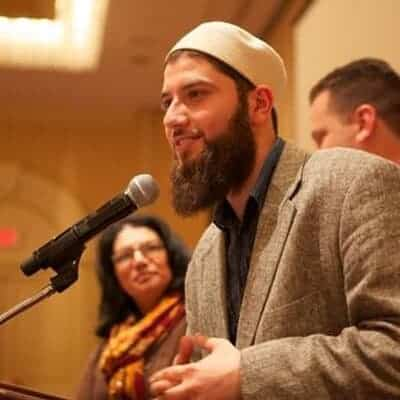 Hassan Shibly speaking at microphone