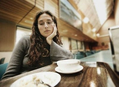 Lady in a caffe not eating - signs of depression