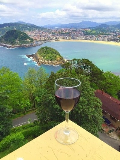 The view with a glass of Ribera del Duero Reserva wine from the top of Monte Igueldo, in San Sebastian, Spain. Image courtesy Greig Santos-Buch.
