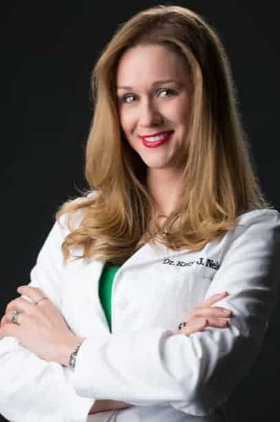 Dr. Katy Nelson in a white lab coat