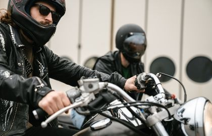 men riding motorcycle in leather jackets
