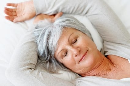 View of a retired senior woman sleeping in bed