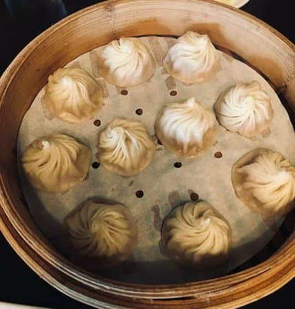 A basket of dumplings from din tai fung in university heights.